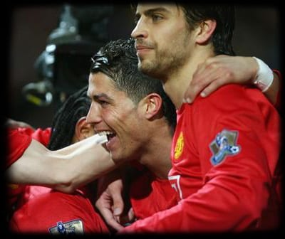 MANCHESTER, UNITED KINGDOM - MARCH 19:  Cristiano Ronaldo of Manchester United (2R) celebrates with team mates Nemanja Vidic (L), Louis Saha (2L) and Gerard Pique (R) as he scores their first goal during the Barclays Premier League match between Manchester United and Bolton Wanderers at Old Trafford on March 19, 2008 in Manchester, England.  (Photo by Alex Livesey/Getty Images)