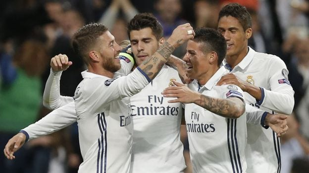 Real Madrid players celebrate with Alvaro Morata, second left, who scored 2-1 during a Champions League, Group F soccer match between Real Madrid and Sporting, at the Santiago Bernabeu stadium in Madrid, Spain, Wednesday, Sept. 14, 2016. (AP Photo/Daniel Ochoa de Olza)