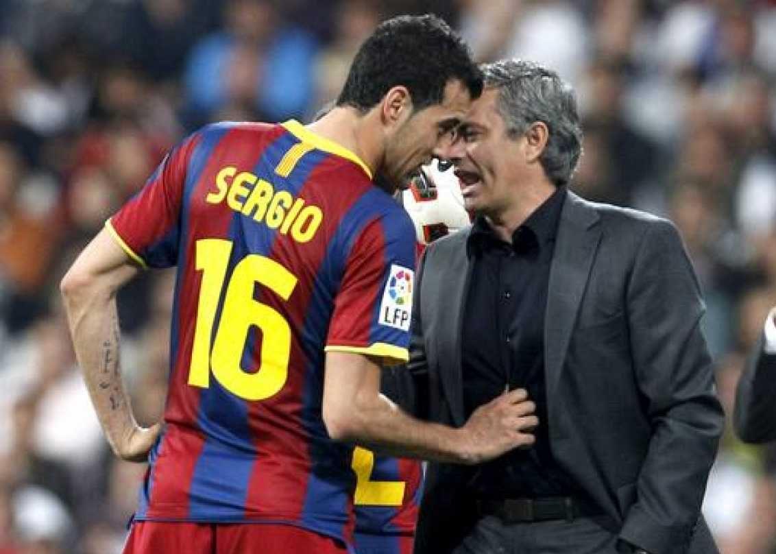 Busquets y Mourinho.